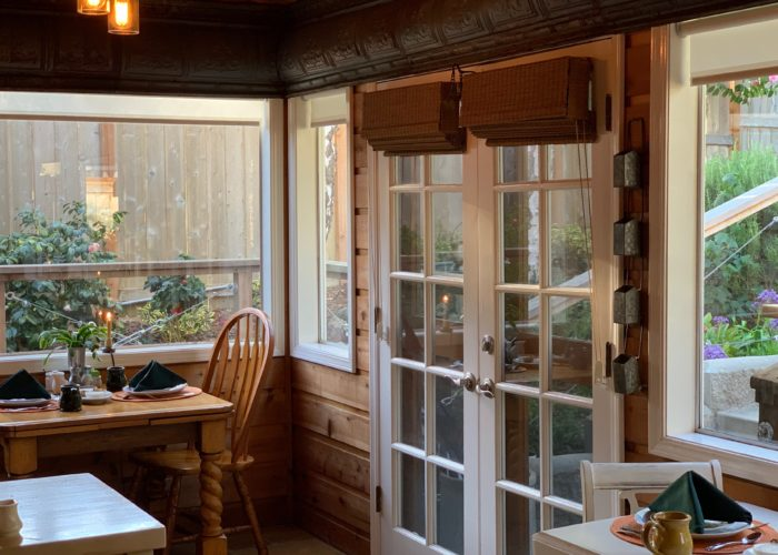 Breakfast dining area with view of back deck